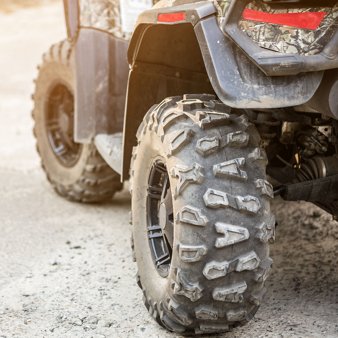 Close-up Tail View Of Atv Quad Bike. Dirty Whell Of Awd All-terr